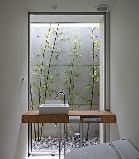 Small, simple, minimal and incredibly beautiful. We're sure you share our love of this #Japanese style bathroom by KK Den. The little #bamboo #garden brings a beautiful sense of tranquility, which is the perfect mood for the #bathroom. Head to homify.com to browse through more inspirational bathrooms.  #house #home #interiordesign #interiordecor #homedesign #homedecor #bathroomideas #cosystyle #modernbathroom #moderndesign #designinspiration #designinspo #bathroominspo #scandinavian #rustic