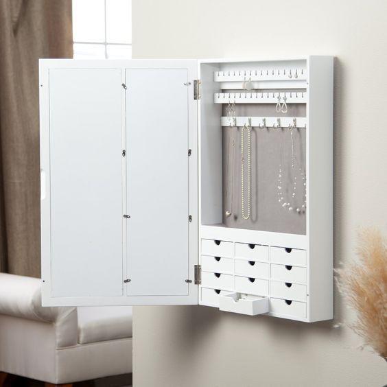 Beautiful minimalist white wall mounted jewelry cabinet with drawers