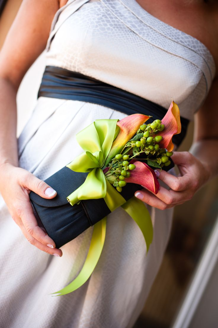The clutch corsage for bridesmaids.. upside? :) bridesmaids can also bring along their lip gloss and phones in their clutches while looking cute walking down the aisle.