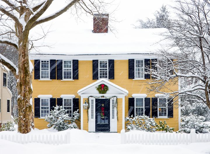 Yellow houses with white trim and dark green shutters look so cozy and trim!