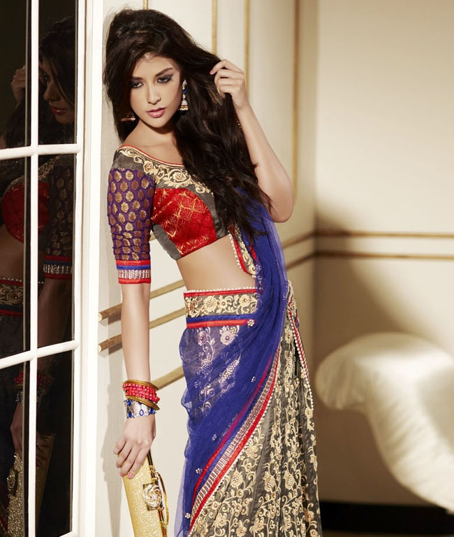 Indian wear for that charming and eternal look that makes you feel closer to heaven. Each piece has elaborate design detailing and sultry silhouettes that are sure to lure you. Look gorgeous in an instant!Indulge yourself with a collection of mesmerizing ethnic wear by Brijraj This range captures the attention of everyone wherever you go, thus making every moment a priceless memory.BRAND: BrijrajCATEGORY: Lehanga Saree with Unstitched BlouseCOLOUR: Red, Blue and MultiMATERIAL: Half Net Half…