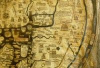 The Hereford Mappa Mundi detail, showing the circular image of Jerusalem (towards the top left) with the Mediterranean Sea below.  Some of the fabulous beasts and monstrous races can be seen on the right.
