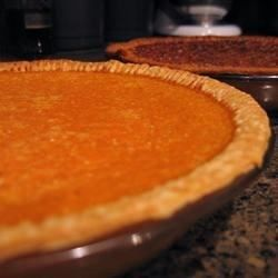 This sweet potato pie is made very creamy with evaporated milk and gets a bit of a kick with rum. Along with sugar, salt, cinnamon, nutmeg, eggs and butter, all the ingredients are put into a food processor and blended until very smooth. Then the filling goes into a pie crust and bakes for less than an hour.