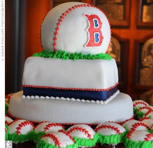 baseball themed wedding | Large baseball cupcakes surrounded a Boston Red Sox inspired groom's ...