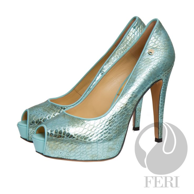 """FERI - SKYE - SHOES - Aqua Blue Print  - Snake skin printed napa leather pump with stiletto heel - Napa leather sole and insole - Colour: Bright teal - FERI logo hardware on sole and outside of heel - Heel height: 4.75"""" with a platform 1.08""""  Invest with confidence in FERI Designer Lines. www.gwtcorp.com/ghem or email fashionforghem.com for big discount"""