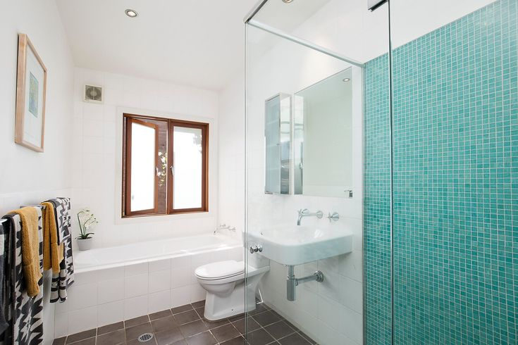 Large main bathroom with bath & separate shower, towels, mosiac tiles, Pilcher Residential