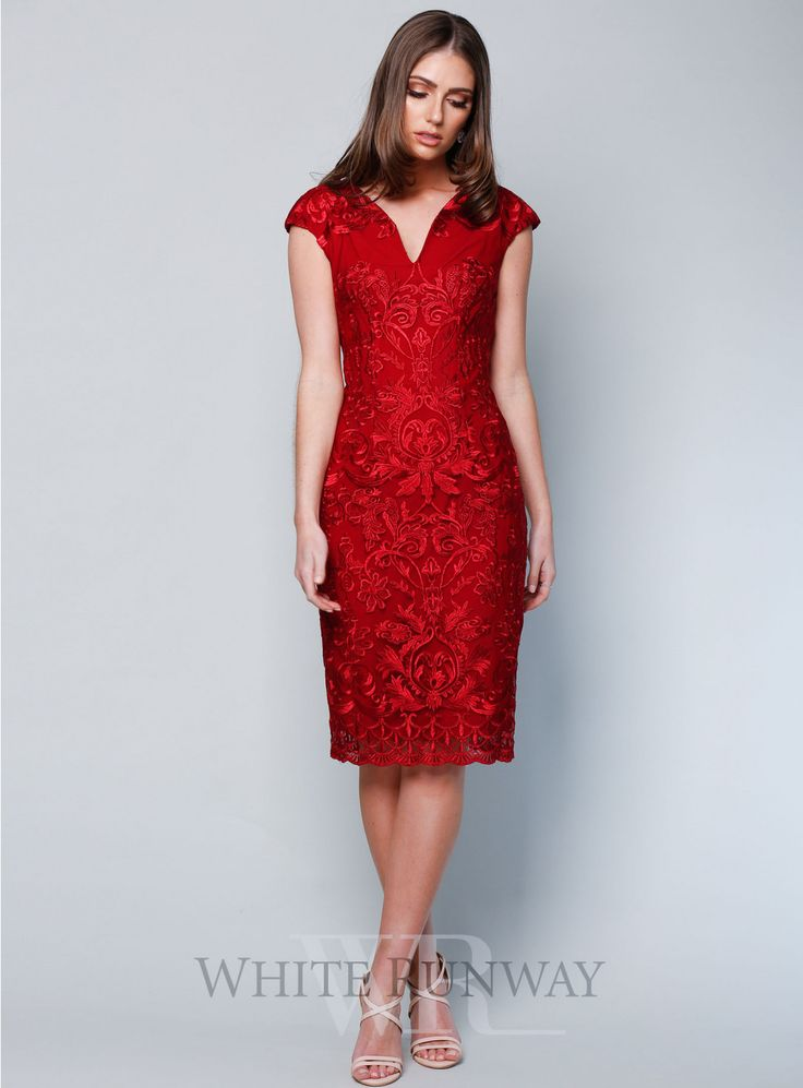 Heather Dress. A stunning cocktail dress by Romance the Label. An embroidered lace style featuring cap sleeves, curved v-neckline and scalloped laced hem.