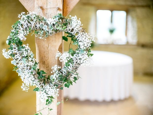 Complement a barn setting with rustic floral touches. Image © The Wedding Cut. #weddingideas #Cotswolds #barnweddings