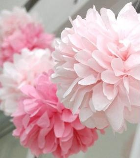 Tissue Paper pom pom's are perfect DIY decorations for #destination #weddings. the paper is light and can pack flat in your suit case. You can then make them with your friends while you tan by the pool.