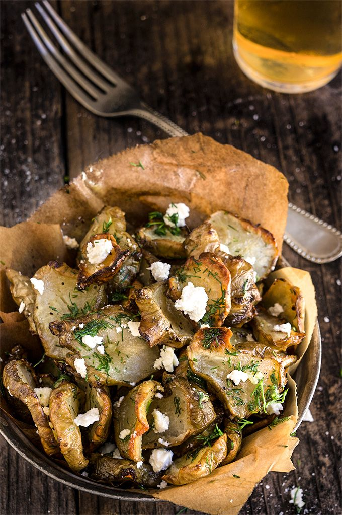Roasted Jerusalem artichokes - sprinkled with feta cheese and drizzled with garlic dill butter - they are simply finger-licking good!   www.viktoriastable.com