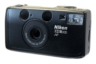 Nikon 300 Zoom AF. Nice little well-built compact 35mm.