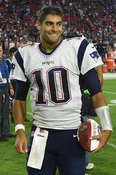 Quarterback Jimmy Garoppolo of the New England Patriots walks off the field…