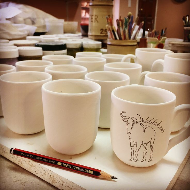 Espresso mugs commission for a game farm. These mugs will be painted in black and white with a Wildebees sketch.