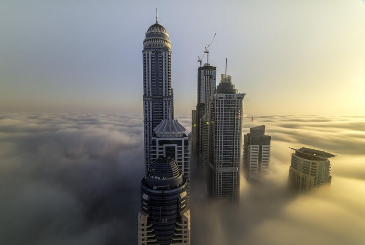 a fogg invasion of the Dubai Marina towers. i took this shot back to 2012 during the sunrise time. Dubai is well known as a fogy city during a certain time of the year.