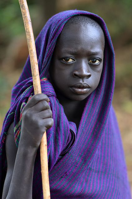 Ethiopia, tribes, Surma, Suri people Boy with Donga stick seen in Bargoba village near Kibish. // by Dietmar Temps