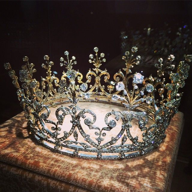 DIAMOND CORONET, LATE 19TH CENTURY. Designed as a series of graduated foliate scrolls, each terminating in an en tremblant spray set with old mine and circular-cut diamonds, to an articulated band, inner circumference approximately 390mm.