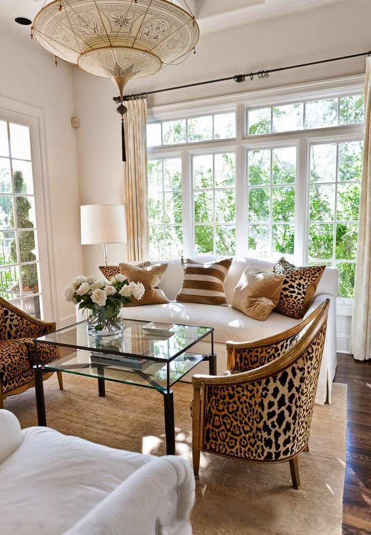 living room sitting room chandelier leopard chairs pillows white sofa couch…