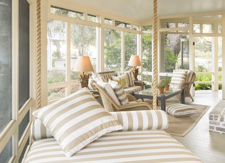 Screened Porch with natural wicker and porch swing  Rebecca Gardner PalmettoBluff  Old