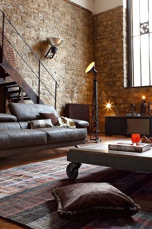 brick wall, neutral, natural lighting, leather, wood, floor pillow, area rug
