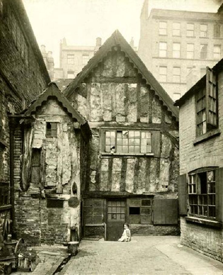 Red Lion Street area, Kirk's Yard, Nottingham, 1919. All demolished in the late 1920's-early 30's and replaced by some of the first purpose built council houses. Narrow Marsh lay beneath the cliff of the Lace Market, seen here in the background. The area was notorious for slum dwellings and outbreaks of cholera and other diseases. The houses on the left show frame-knitters windows. The timber-frame house, 'Marsh Farm' may be Tudor, with a marvellous display of repairs and patching.