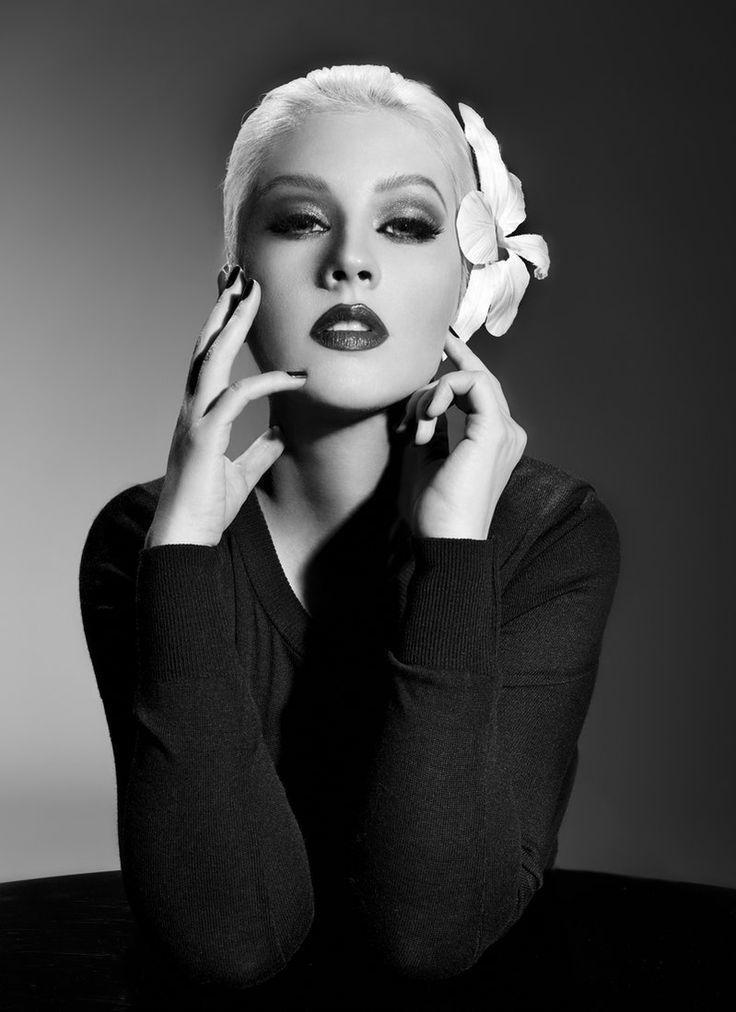 Christina Aguilera sporting a Billie Holiday inspired flowered fascinator - byJake Bailey.