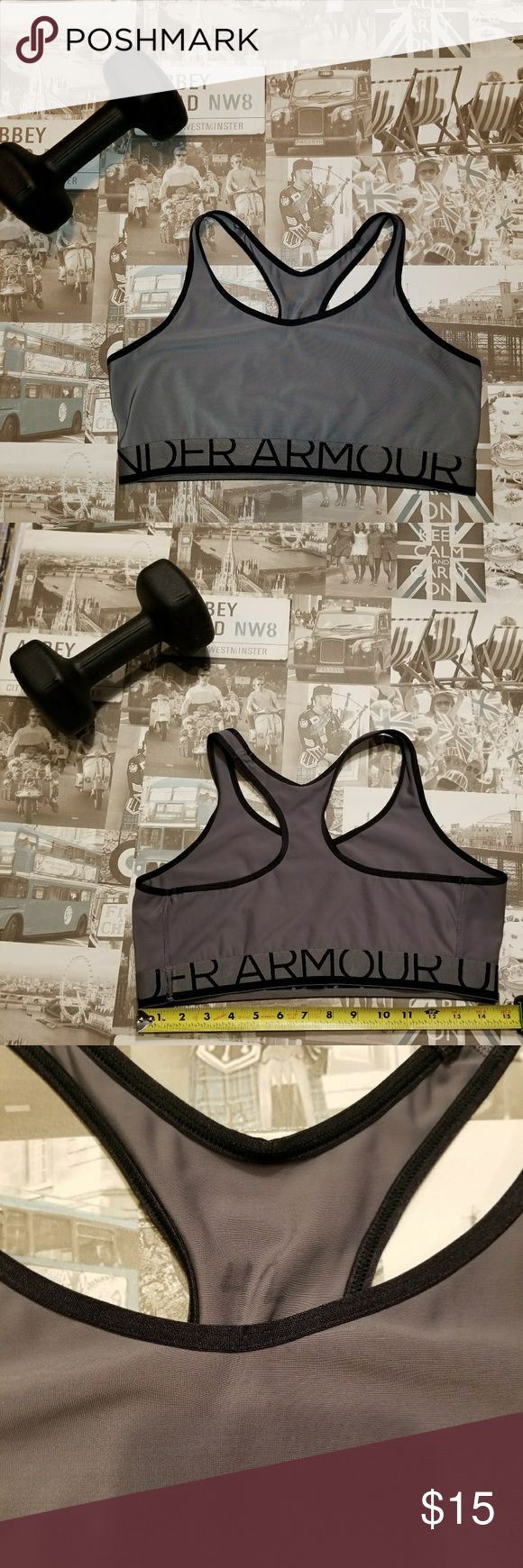 Under Armour Black and Grey Sports Bra Size Large Polyester with elastic band. In good shape but tags removed for comfort and #42 written lightly inside. Clean smoke and pet free home. Save big when you bundle! Under Armour Intimates & Sleepwear Bras