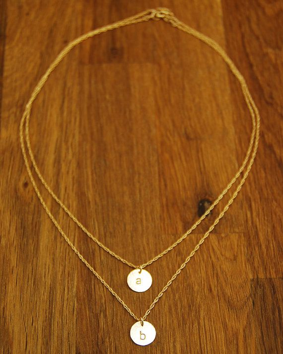 layered Initial necklace. Would love this in a n for nick and a j for Jonathan but in silver