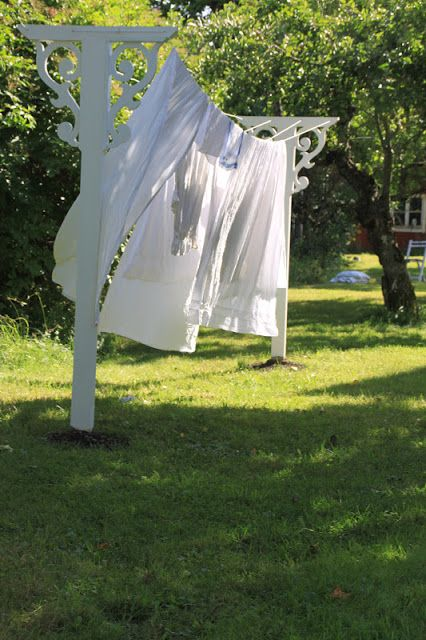 Clothesline DIY redone.. too cute!! clothes line using existing 4x4 post. Set another, add brackets, and corner trim, hooks to hold clothesline.