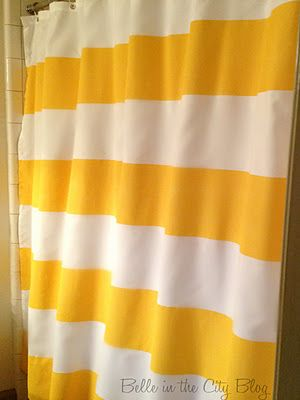 painting a white shower curtain, brilliant idea! i would not choose this color though, and i might do thinner vertical stripes instead.