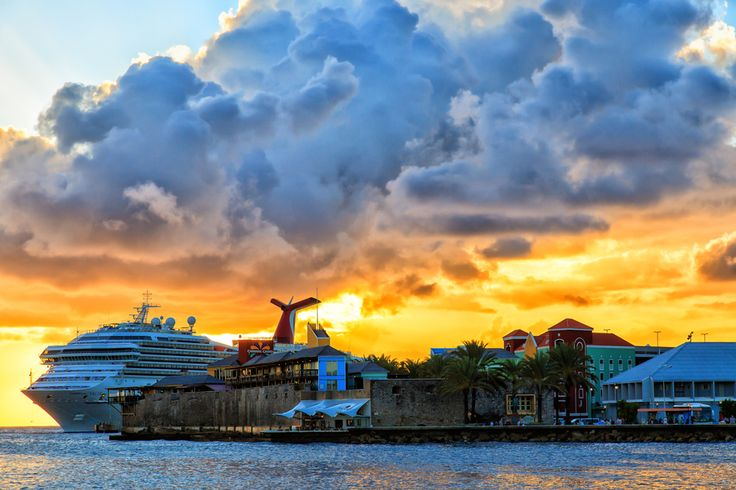 Sunset in Curacao with a view of the Carnival Valor.   Email:info@cloud9getaways.com for Carnival Cruise booking info! www.cloud9getaways.com  #Cloud9Getaways  #CarnivalCruise #CCL