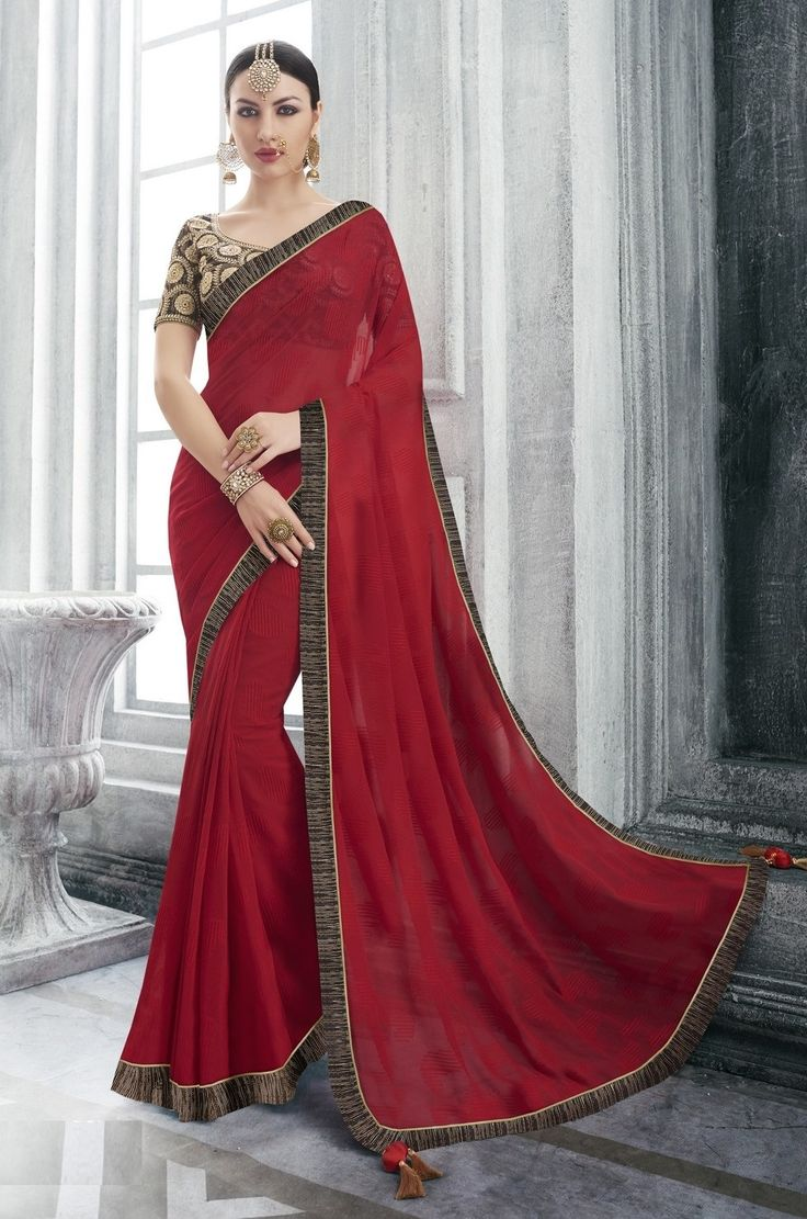 Price @2085.00 INR  Colour : Red Saree Fabric :  Georgette   Blouse Fabric :  Fancy Blouse            Work :  Heavy Embroidery