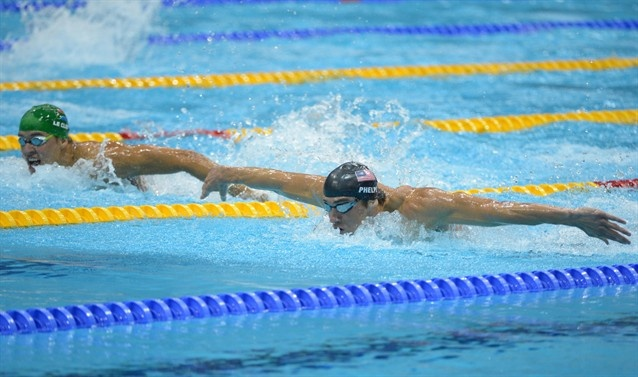 Michael Phelps (USA) swims in the lane next to Chad le Clos (RSA) in the men's 200m butterfly final.    Flying through the water...love the wingspan.    #olympics2012