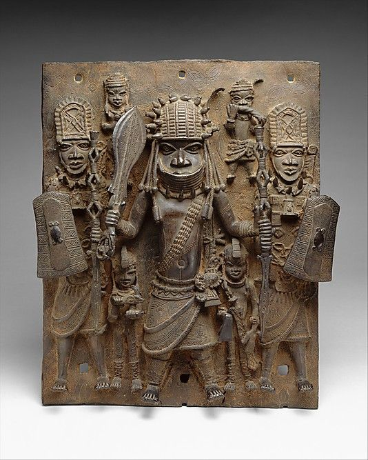 Plaque: Warrior and Attendants Date: 16th–17th century Geography: Nigeria, Court of Benin Culture: Edo peoples Medium: Brass Dimensions: H. 18 3/4 in. (47.6 cm) Classification: Metal-Sculpture