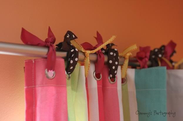Cute window treatment......a shower curtain and ribbon - try multi color ribbon and white curtain.