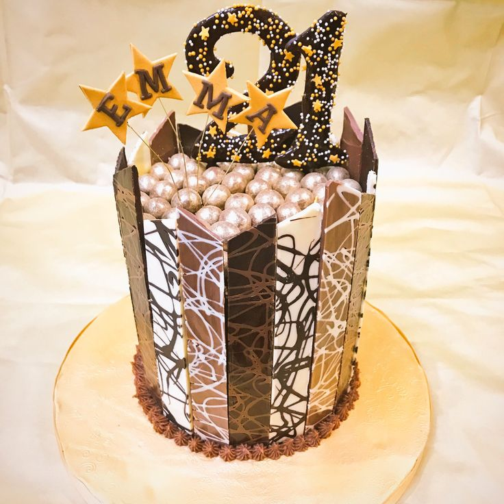 Chocolate shard 21st birthday cake with golden Malteser topping