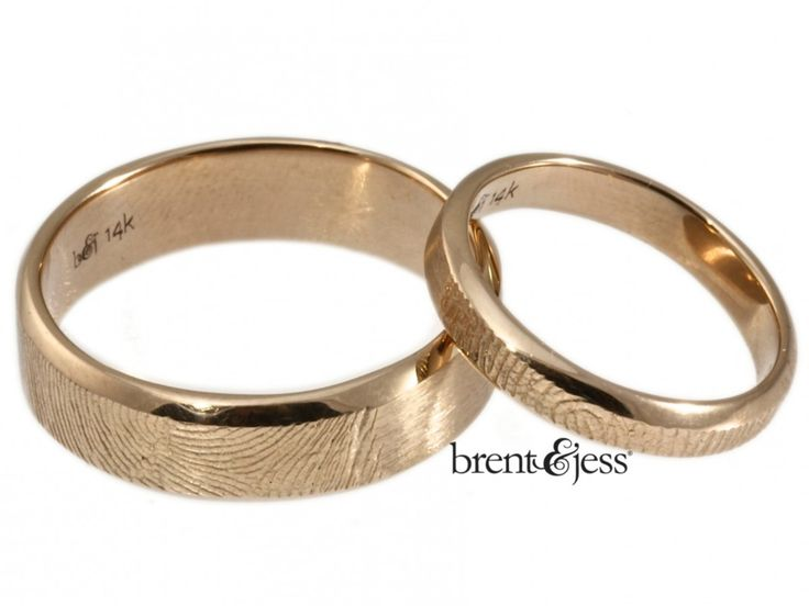 These warm-toned wedding bands are handcrafted in 14k rose gold, with your loved one's fingerprint wrapped on the outside. The fingerprint is presented natural for a subtle texture, but can be darkened for more contrast. The beveled style has a clean, modern look, and its low profile sits nicely next to many styles of engagement ring. Our rings are also available in sterling silver, platinum, palladium, white, and yellow gold. Pleasecontact uswith your ring sizes for pricing information...