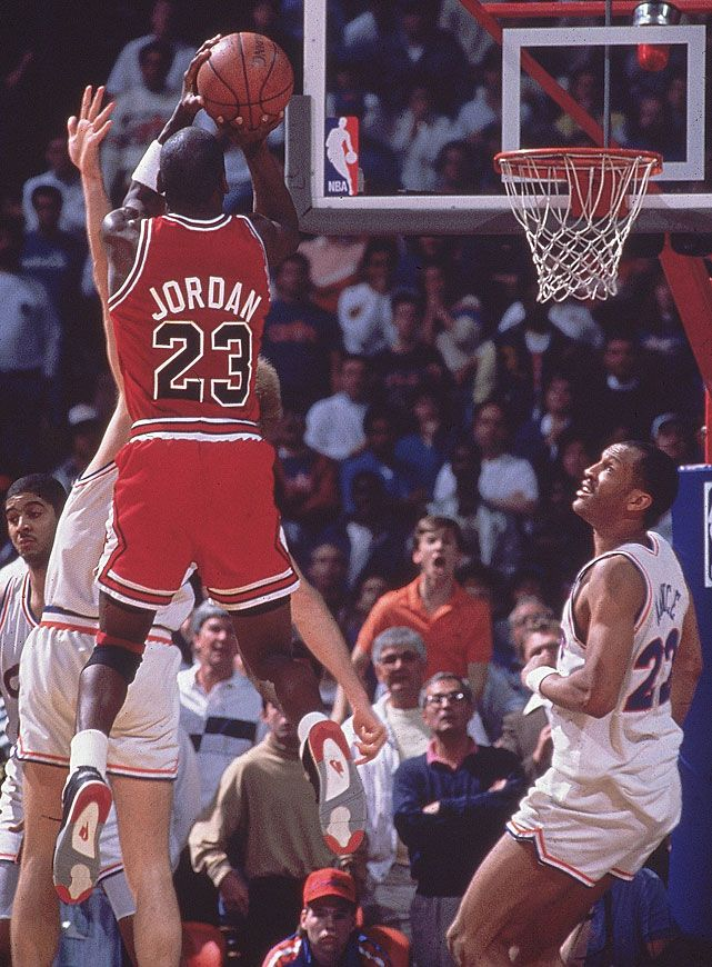 "Michael Jordan's famous jumper over Craig Ehlo during the fifth game of the 1989 Eastern Conference First Round. ""The Shot"" is considered one of Jordan's top clutch moments and the reaction of the announcers make it one of the most recognizable plays in NBA history. (Manny Millan/SI)"