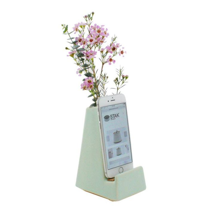 <p>Features a storage compartment for your desk accessories or flowers. Charging cable threads in the opening at the base and is hidden from view.</p> <p>Maker Name: STAK Ceramics.</p>