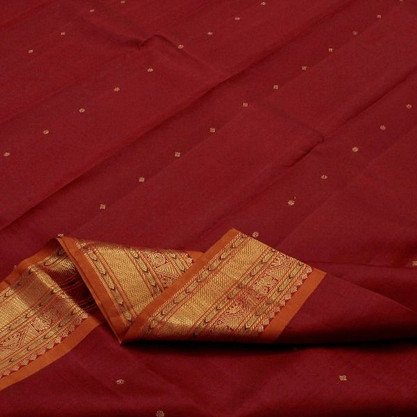 A melting pot of blood red rubies in handwoven #silk! This exquisite #Kanjivaram is perfect for weddings, pujas and traditional get-togethers with its auspicious haldi-kumkum combination. The radiant maroon body appears to be sprinkled with gold dust in woven dots to add shimmer and shine. The gold border is trimmed with haldi-coloured stripes on either side, geometrically enveloping elephant and peacock motifs.For saris in this exotic colour, visit Sarangi. Code 390119537.