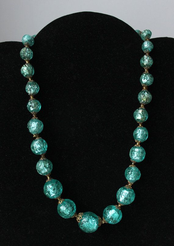 Circa 1940 Necklace compose with graduated Czech Bohemian textured foiled glass beads. These fabulous blue turquoise foil glass beads appear as glowing