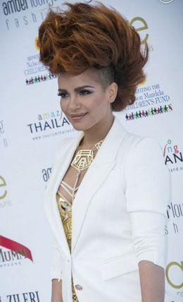 Eva Simons wearing a personally customized limited edition golden karo longline bra