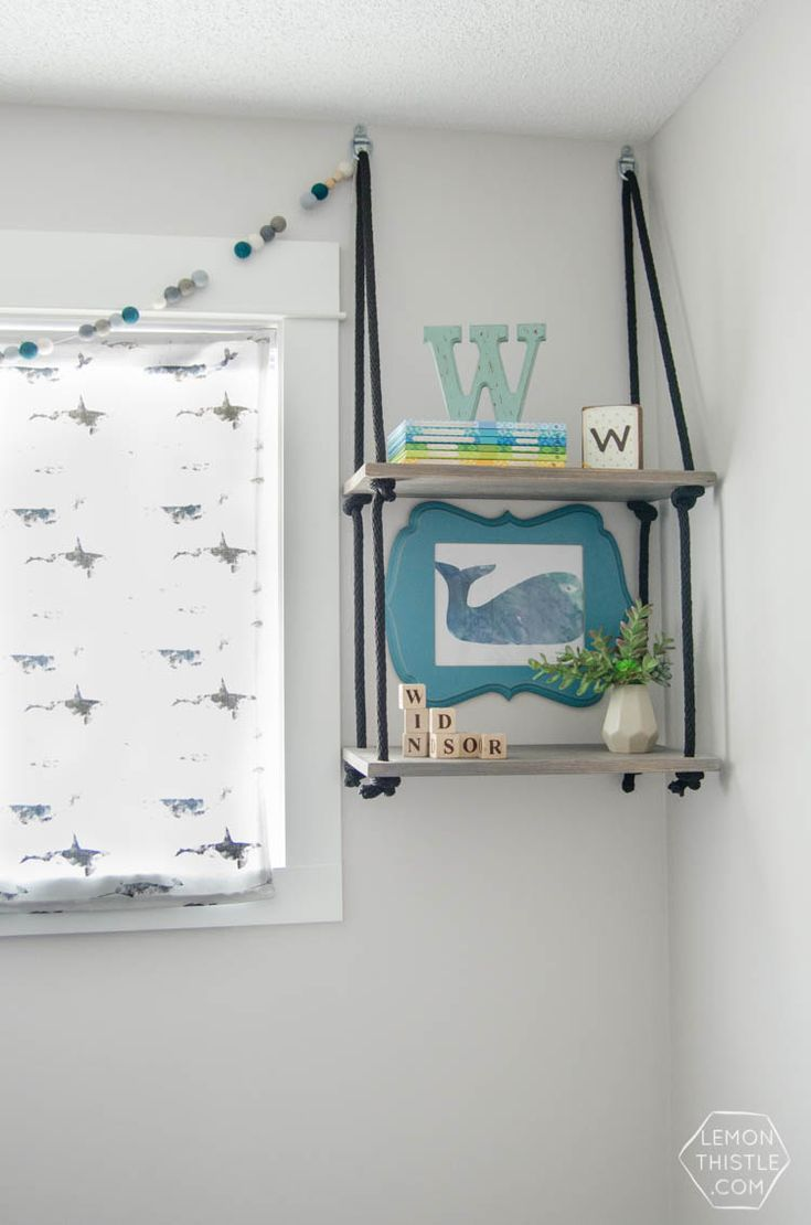 I love these hanging shelves for a nursery such a cool for Nursery hanging storage