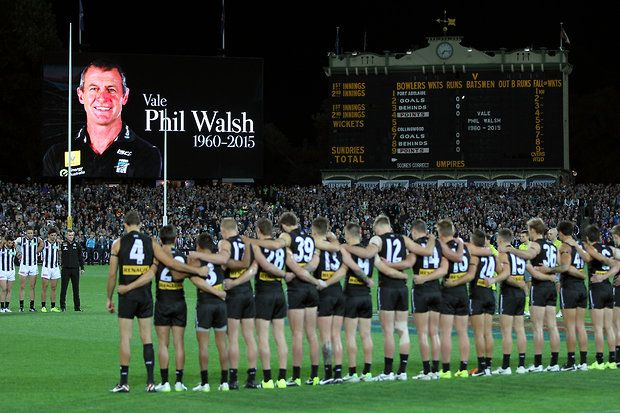 ADELAIDE, AUSTRALIA - JULY 9: Tribute to Phil Walsh on the old scoreboard during the 2015 AFL round 15 match between Port Adelaide Power and the Collingwood Magpies at the Adelaide Oval, Adelaide, Australia on July 9, 2015. (Photo by James Elsby/AFL Media)