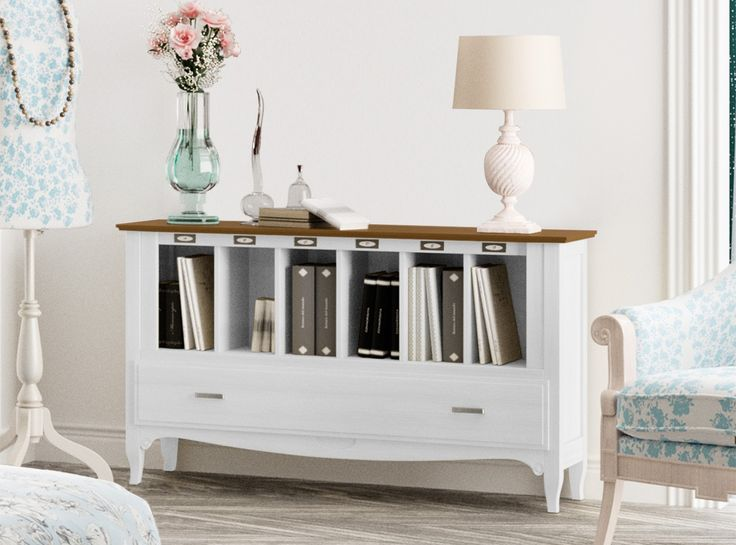 Elegante y práctico librero de 135 cm en madera maciza con 1 cajón. Una pieza polivalente que encajará en cualquier espacio de tu hogar.  Si lo deseas puedes complementarlo con un conjunto de 4 espejos a juego.