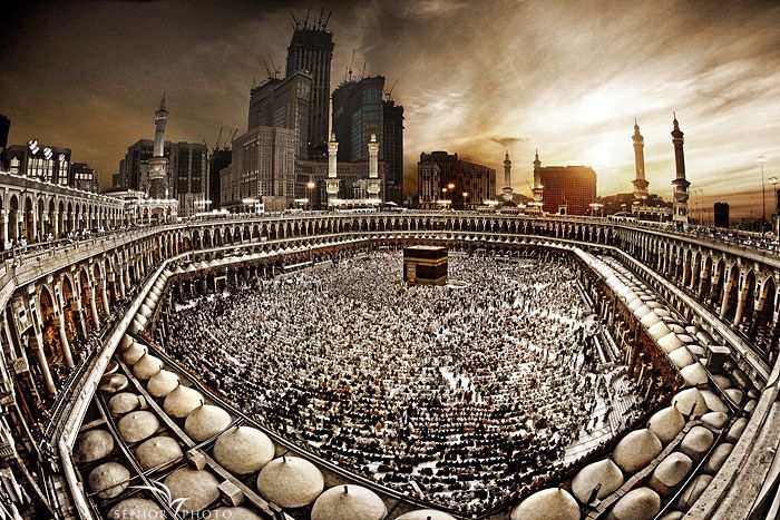 """Al-Masjid al-Ḥarām (""""The Sacred Mosque"""") surrounds Islam's holiest place, the Kaaba. It is located in the city of Mecca and is the largest mosque in the world. Muslims around the world turn toward Kaaba while performing any prayer. One of the Five Pillars of Islam requires every Muslim to perform the Hajj pilgrimage, at least once in his or her lifetime if able to do so, including circumambulation of Kaaba."""