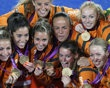 The Netherlands team pose with their golden medals during the women