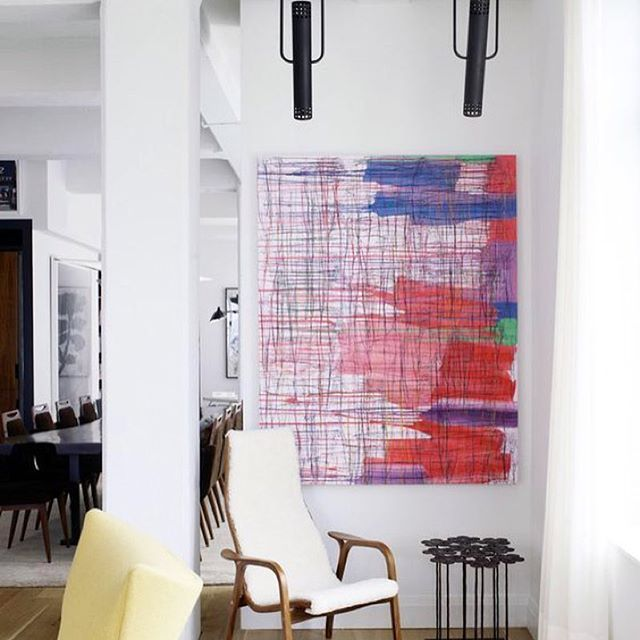 The white chair is by midcentury, Danish designer Vestergaard-Jensen.  The painting is by Ghada Amer and the table is by Hubert le Gall