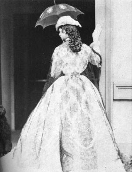 1865 Sisi from back in Kramer photo set  PreviousNextList  Sisi has opened her parasol and displays her elaborate coiffure and lace wrap in this Albert of Munich photo.    And wouldn't I just love to know how she  did her hair like that!