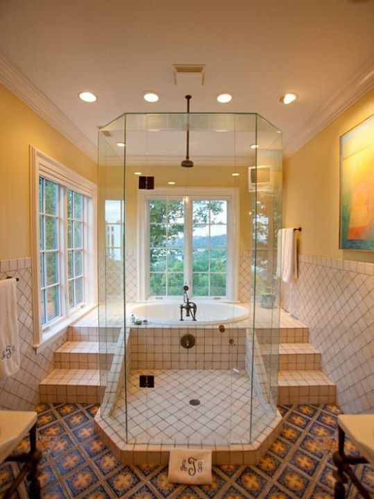 A very elegant walk-in shower an sunken bath dont know about the windows though