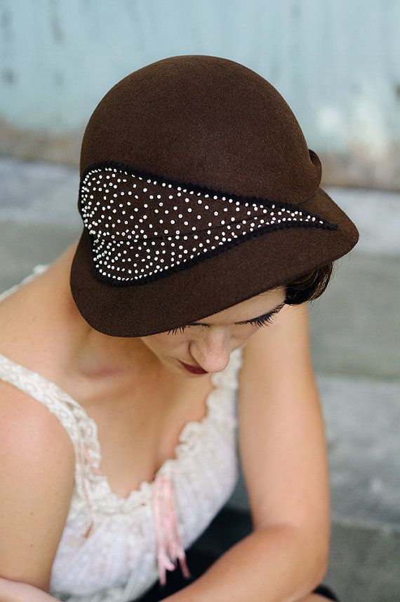 Autumn in New York  hand draped cloche cap The leaf design on the hat is made out of glass vintage beads. It is hand beaded, which took forever. :)